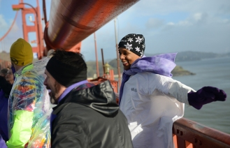 "June Solomon stretches her arms over the edge of the Golden Gate Bridge in San Francisco, Ca. on Friday, January 20, 2016 during a ""Bridge Together"" demonstration. The event was coordinated by Satoriteller, a San Francisco art-based production studio to take place at the same time as the inauguration of President-elect Donald Trump to raise awareness for bullying and to take a stand against bullying rhetoric nationwide. Photo by David Andrews and is Property of Hoodline and Pixel Labs, Inc. Photo by David Andrews."