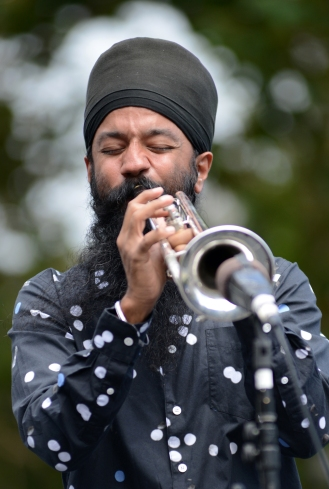 Sonny Singh, trumpet player of the band Red Baraat, rips a solo during a performance at the Yerba Buena Gardens Festival in San Francisco, Ca. on Saturday, August 27, 2016. Attendees of the free festival at Yerba Buena Gardens were treated to the high energy sounds of the rock and roll, funk, jazz, Punjabi, soulful eight-piece Bhangra band from Brooklyn, Ny. Photo by David Andrews.