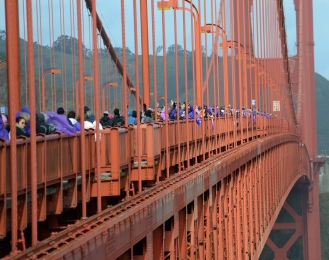 "Participants dressed in purple span the Golden Gate Bridge in San Francisco, Ca. on Friday, January 20, 2016 during a ""Bridge Together"" demonstration. Satoriteller, a San Francisco art-based production studio, urged participants to wear purple - the color of anti-bullying awareness - to the event that took place during the inauguration of President-elect Donald Trump. See more - tinyurl.com/BridgeTogether Photo by David Andrews"