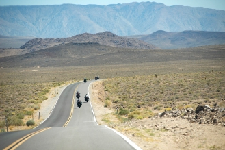 Motorcyclists ride along CA-190 en route to Death Valley National Park in Darwin, Ca. on Wednesday, June 6, 2018. Photo by David Andrews